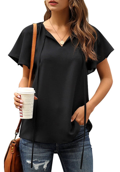Front view of model wearing black tie-up neckline flared short sleeves plain top