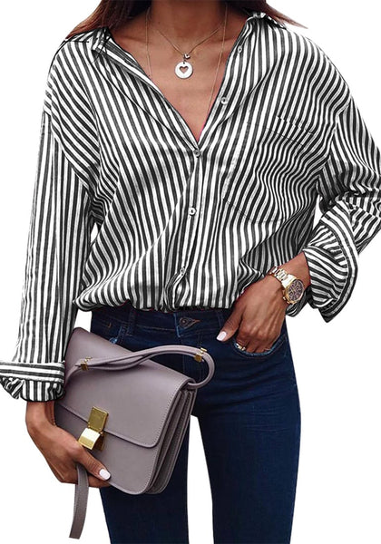 Front view of model wearing black vertical striped long sleeves button-up top