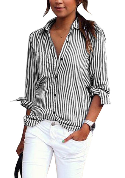 Front view of model wearing black vertical striped long sleeves button-up top pairing it with white pants