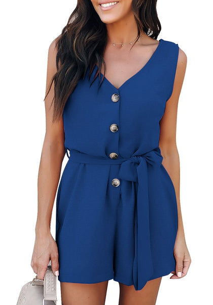 Front view of model wearing blue V-neck sleeveless belted button-up romper