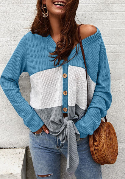 Front view of model wearing blue V-neckline button-up tie-front colorblock waffle knit top