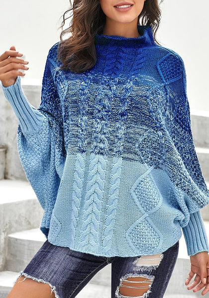 Front view of model wearing blue batwing sleeves ombre turtleneck cable knit sweater