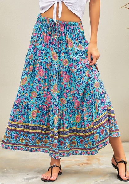 Front view of model wearing blue boho floral-print elastic waist maxi skirt