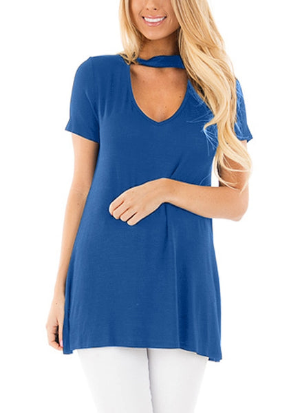 Front view of model wearing blue choker-neck short sleeves top