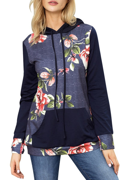 Front view of model wearing blue floral long sleeves pocket pullover hoodie