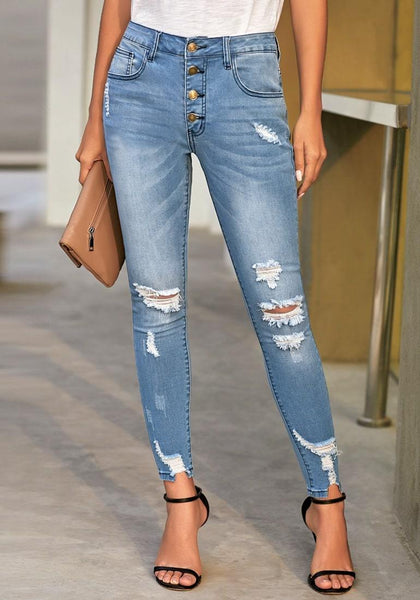 Front view of model wearing blue high-rise buttoned cropped denim skinny jeans