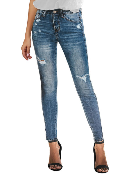 Front view of model wearing blue high-rise ripped skinny denim jeans