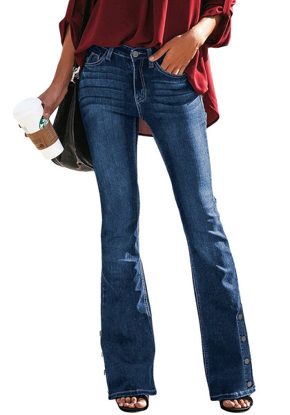 Front view of model wearing blue mid-waist side buttons flared denim jeans