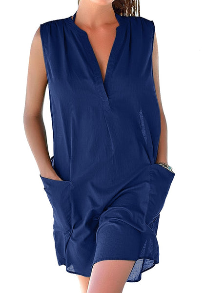 Front view of model wearing blue notched V-neck sleeveless beach cover-up