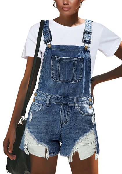 Front view of model wearing blue raw hem pockets out ripped shorts overall