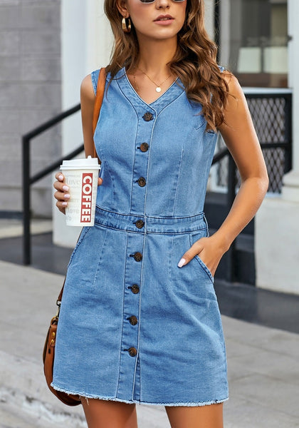 Front view of model wearing blue raw hem sleeveless button-down denim dress