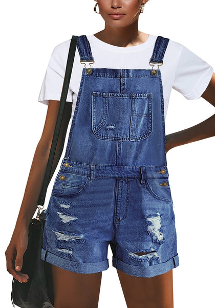Front view of model wearing blue roll-over hem ripped denim shorts overall