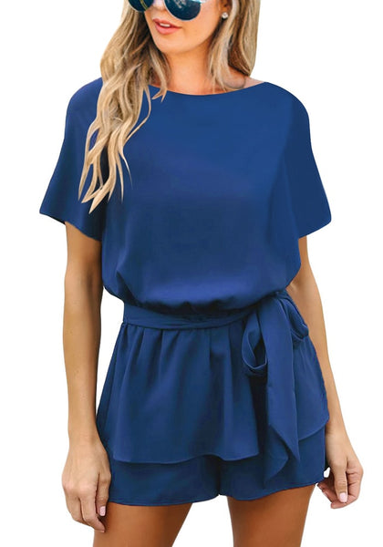 Front view of model wearing blue short sleeves keyhole-back belted romper