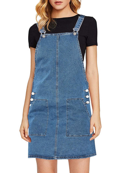 Front view of model wearing blue side pockets overall denim pinafore dress