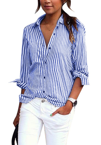 Front view of model wearing blue vertical striped long sleeves button-up top pairing it with white pants