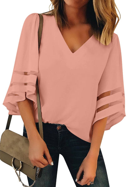 Front view of model wearing blush pink 34 bell mesh panel sleeves V-neckline loose top