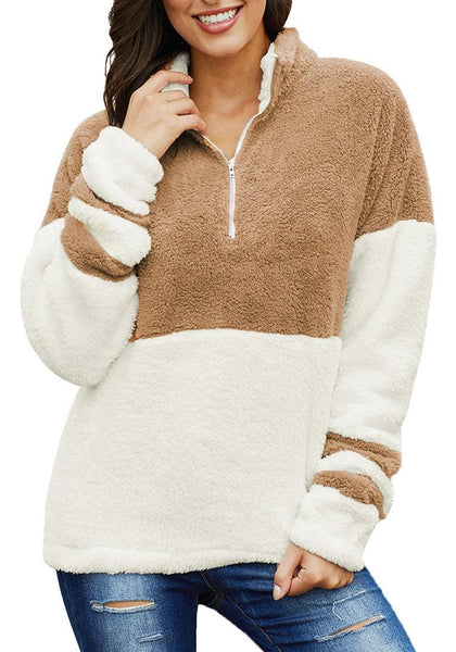 Front view of model wearing brown colorblock half-zip fuzzy fleece pullover