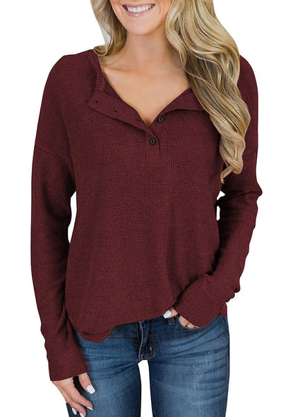 Front view of model wearing burgundy waffle knit pullover henley top