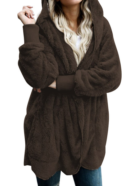 Front view of model wearing coffee snuggle fleece oversized hooded cardigan