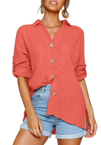 Front view of model wearing coral collared V-neckline cuffed sleeves button-up top