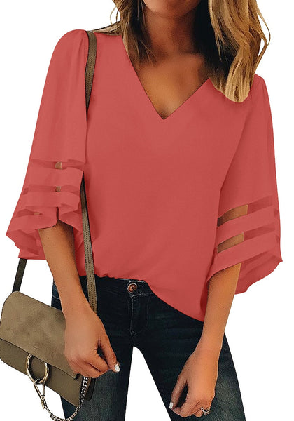 Front view of model wearing coral pink 34 bell mesh panel sleeves V-neckline loose top