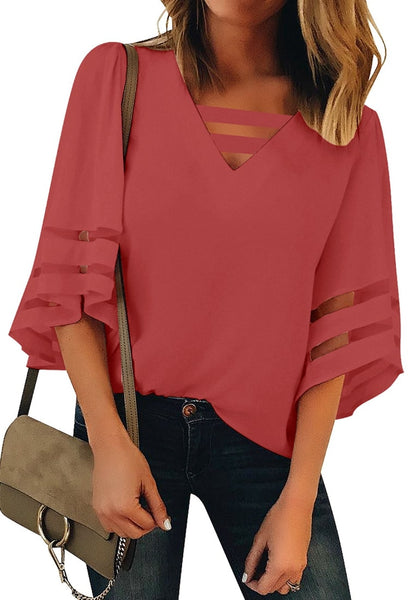 Front view of model wearing coral pink 34 bell mesh panel sleeves strappy V-neckline loose top