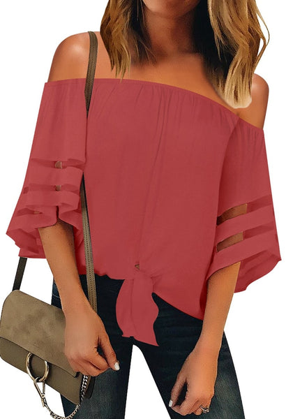 Front view of model wearing coral pink 34 bell mesh panel sleeves tie-front off-shoulder top