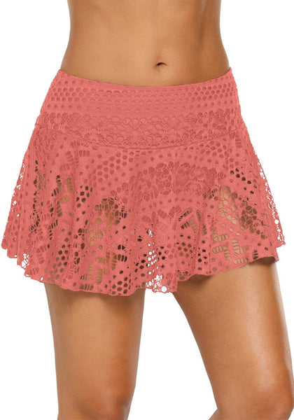 Front view of model wearing coral pink lace crochet swim skirt