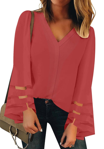 Front view of model wearing coral pink overlap V-neckline long bell mesh sleeves loose top