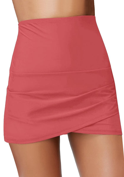 Front view of model wearing coral tulip hem high waist ruched swim skirt