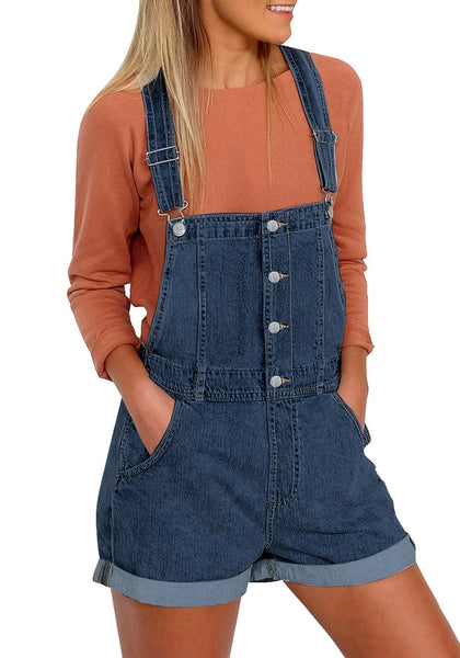 Front view of model wearing dark blue button-front rolled hem shorts denim overall