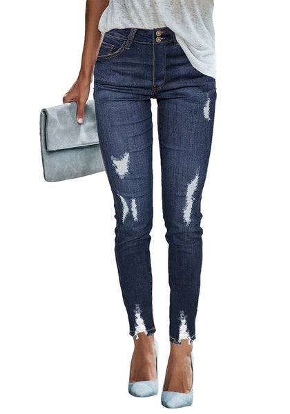 Front view of model wearing dark blue double button ripped skinny denim jeans