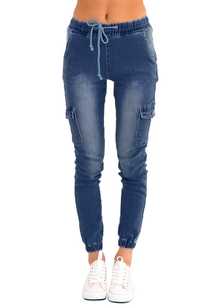 Front view of model wearing dark blue elastic waist mid-rise skinny jogger pants