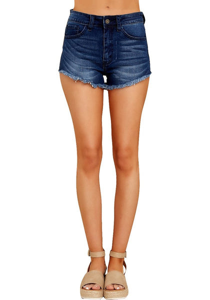 Front view of model wearing dark blue frayed raw hem washed denim shorts