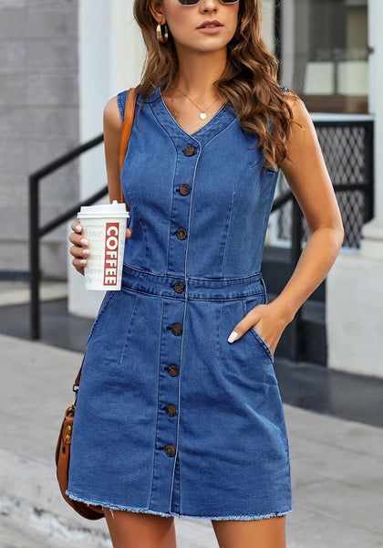 Front view of model wearing dark blue raw hem sleeveless button-down denim dress