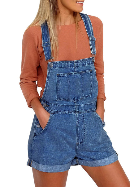 Front view of model wearing dark blue rolled hem shorts denim bib overall