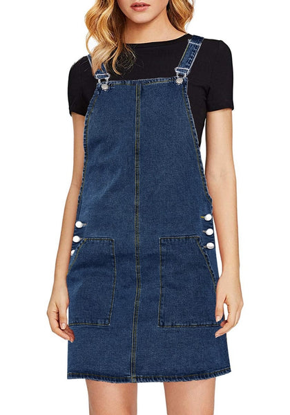 Front view of model wearing dark blue side pockets overall denim pinafore dress