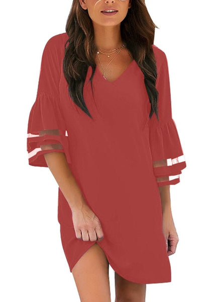 Front view of model wearing dark coral pink 34 mesh sleeves V-neck mini shift dress