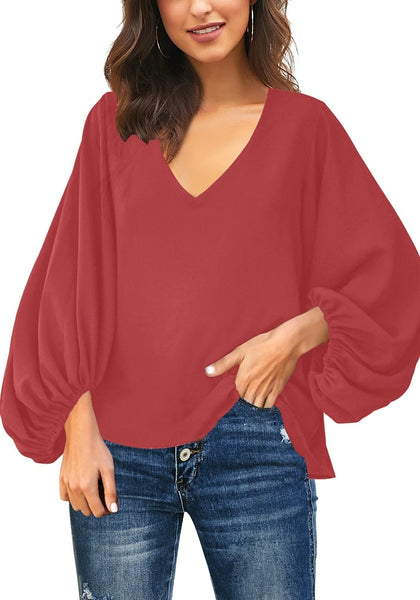 Front view of model wearing dark coral pink V-neckline balloon sleeve plain blouse