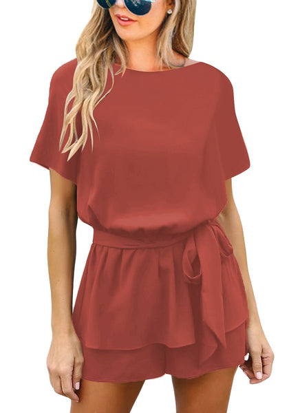 Front view of model wearing dark coral pink short sleeves keyhole-back belted romper