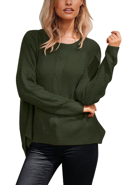 Front view of model wearing dark green ribbed knit textured side-slit sweater