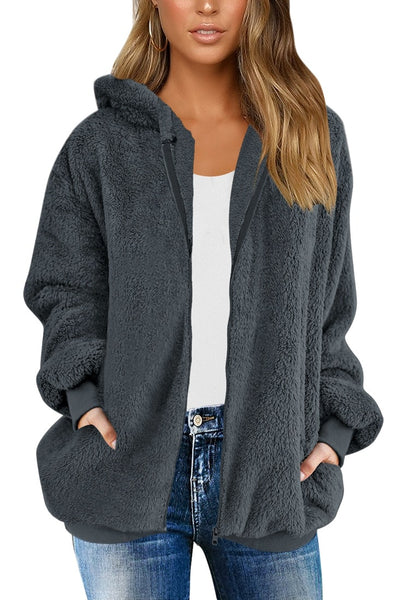 Front view of model wearing dark grey fuzzy fleece hooded oversized coat