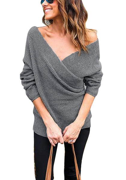 Front view of model wearing dark grey ribbed wrap sweater