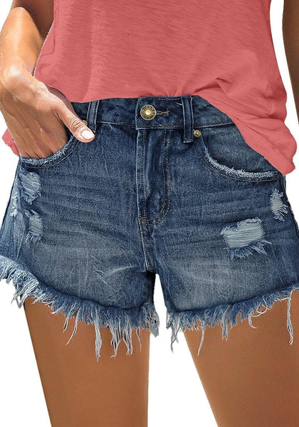 Front view of model wearing deep blue frayed raw hem ripped denim shorts