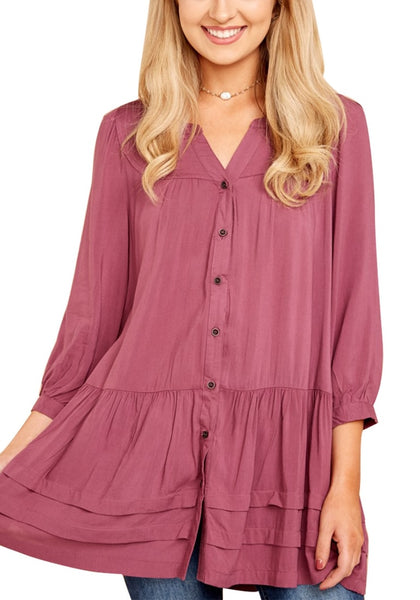Front view of model wearing deep blush button-front puffed sleeves tunic