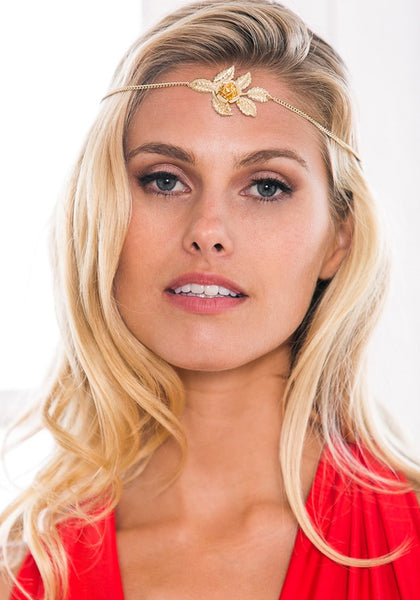 Front view of model wearing gold rose boho headpiece