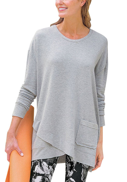 Front view of model wearing grey asymmetrical tulip hem pullover tunic top