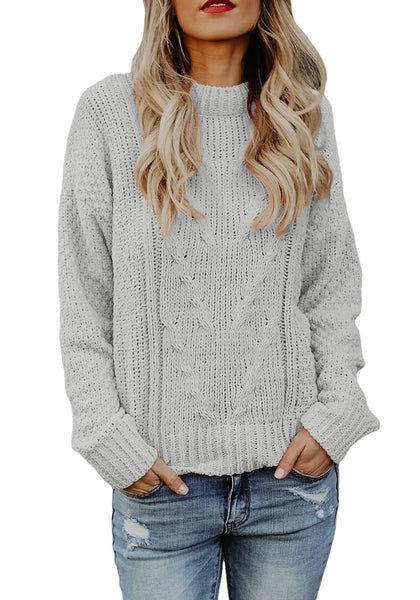 Front view of model wearing grey crew neck velvet cable knit pullover sweater