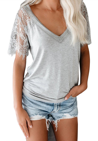 Front view of model wearing grey crochet lace short sleeves V-neckline top