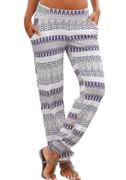Front view of model wearing grey ethnic-print straight cut smocked pants